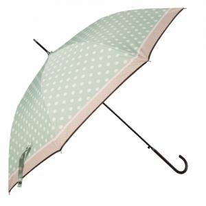 hellgrüner Regenschirm mit Punkten